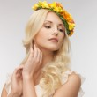 Woman wearing wreath of flowers — Stock Photo #24685355