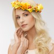 Woman wearing wreath of flowers — Stock Photo #24685365