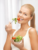 Healthy woman holding bowl with salad — Stock Photo