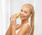 Woman eating junk food — Stock Photo