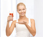 Woman holding glass of tomato juice — Stock Photo