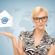 Woman showing virtual envelope — Stock Photo #24750867