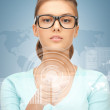 Businesswoman pointing at virtual screen — Stock Photo #24751205