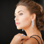 Woman with diamond earrings — Stock Photo #24753369