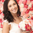 Woman with background full of roses — Stock Photo #24754127