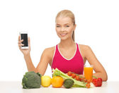 Woman with fruits, vegetables and tablet pc — Stock Photo