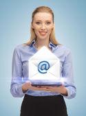 Woman showing virtual envelope — Stock Photo