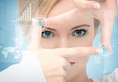 Woman creating frame with fingers — Stock Photo