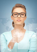 Businesswoman pointing at virtual screen — Stock Photo