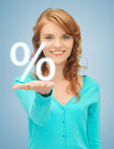 Girl showing sign of percent in her hand — Stock Photo