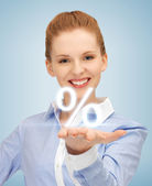 Woman showing sign of percent in her hand — Stock Photo