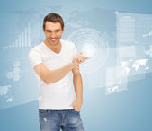 Man touching virtual screen — Stock Photo