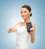 Woman showing smartphone with app — Stock Photo