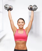 Woman with heavy steel dumbbells — Stock Photo