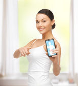 Woman showing smartphone — Stock Photo