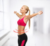 Sportswoman with raised up hands — Stock Photo