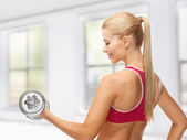 Woman with heavy steel dumbbell — Stock Photo