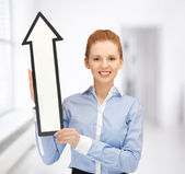 Woman with direction arrow sign — Stock Photo