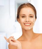 Beautiful woman with moisturizing creme drop — Stock Photo