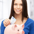Lovely woman with piggy bank and money — Stock Photo #25009879