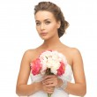 Woman with bouquet of flowers — Stock Photo #25107973