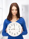 Woman holding big clock — Stock Photo