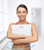 Woman with scale — Stock Photo