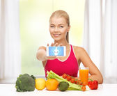 Woman with fruits, vegetables and smartphone — Stock Photo