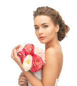 Woman with bouquet of flowers — Stockfoto