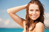 Woman in bikini smiling — Foto Stock