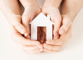 Woman and hands with paper house — Stock Photo