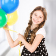 Happy girl with colorful balloons — Stock Photo #25271141