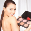 Lovely woman with palette and brush - Stock Photo