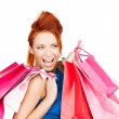 Excited woman with shopping bags - Stock Photo
