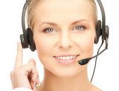 Friendly female helpline operator — Stock Photo