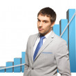 Handsome businessman with big 3d chart — Stock Photo