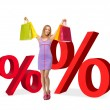 Woman with shopping bags and percent signs - Stock Photo