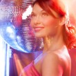 Woman with disco ball - Stockfoto