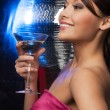 Woman with cocktail and disco ball - Stockfoto