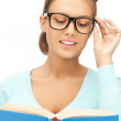 Woman in glasses reading book — Stock Photo