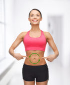 Woman with arrows on her stomach — Stockfoto