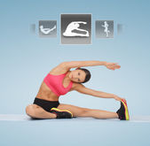 Woman stretching on the floor — Stock Photo