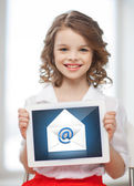 Girl with tablet pc and envelope icon — Stock Photo