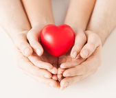 Woman and man hands with heart — Stockfoto