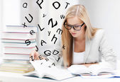 Student with books and notes — Stock Photo