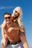 Couple having fun on the beach — Stock Photo