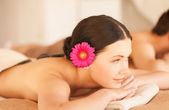 Woman in spa with hot stones — Stock Photo