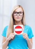 Woman with no entry sign — Stockfoto