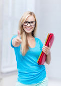 Smiling student with folders — Stock fotografie