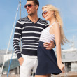 Happy young couple in port — Stock Photo #25998349